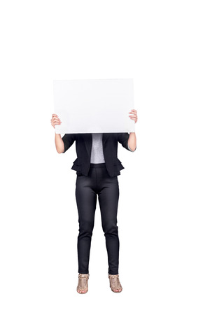 Portrait of businesswoman holding blank white banner standing isolated over white background. Empty white banner for copyspace Stock Photo