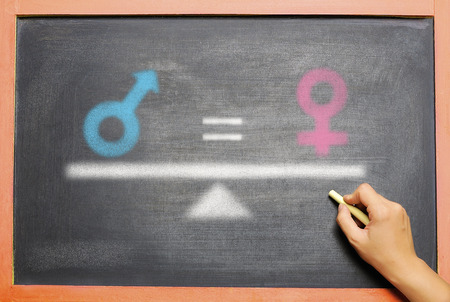 Gender of male is equal with female drawn on the chalkboard. Equality gender concept Stock Photo