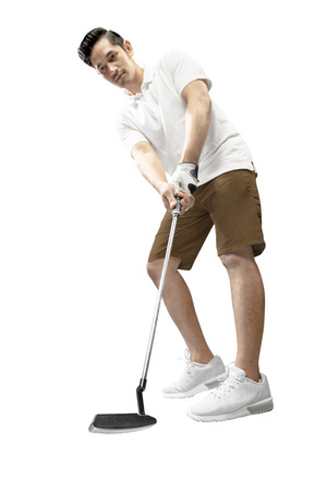 Handsome asian man golf player swing the putter club to put the ball into the hole standing isolated over white background Stock Photo