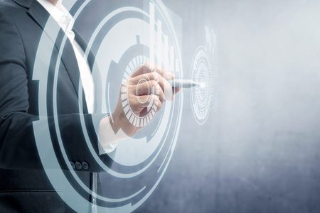 Businessman drawing with marker on virtual screen which display the interface of world map and binary code. Digital technology concept