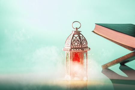 Arabic lamp with beautiful light and holy koran. Islamic concept image for ramadan Stock Photo