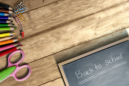 School supplies and stationery with little blackboard with Back to School text on wooden table. Back to School concept Stockfoto