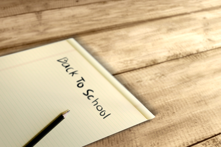 Paper and pencil with Back to School message on wooden table. Back to School concept Stockfoto