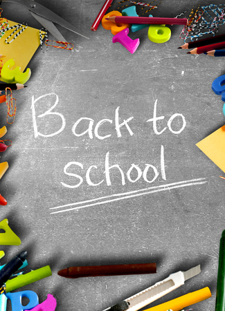 School supplies and stationery on blackboard with Back to School text. Back to School concept 版權商用圖片