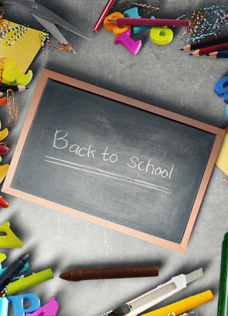 School supplies and stationery on blackboard and little chalkboard with Back to School text. Back to School concept