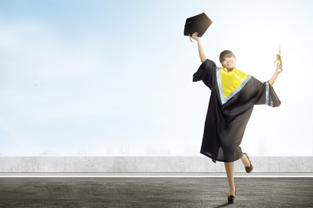 Asian woman holding mortarboard hat and diploma celebrate graduation from college. Graduation concept