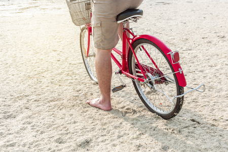 Man riding bicycle on the beach. Summer vacation