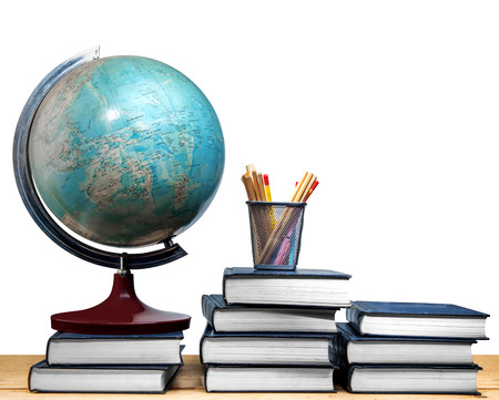 Pile of books and globe with pencils in basket container on wooden table isolated over white background. Back to School concept Stockfoto
