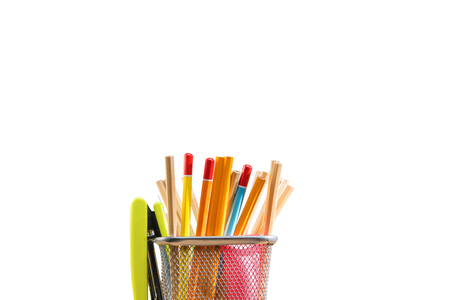 Pencils in basket container with green stapler isolated over white background. Back to School concept Stockfoto