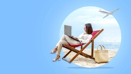 Asian business woman working with laptop sitting in the beach chair on beach with plane on the sky. Traveling concept