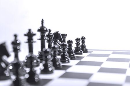 Whole group of black chess piece on the chessboard
