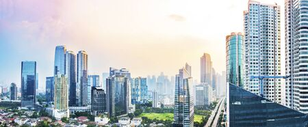 Panoramic Jakarta skyline with urban skyscrapers in the afternoon. Jakarta, Indonesia