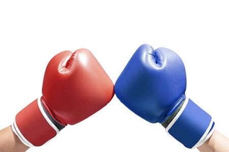 Hands of two men with blue and red boxing gloves isolated over white background Stock fotó