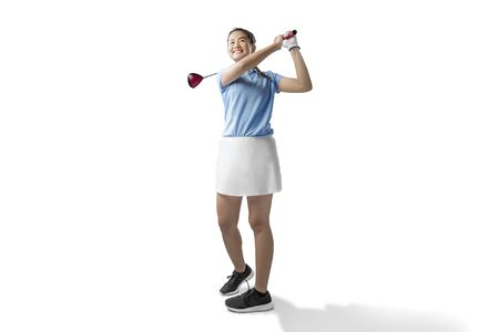 Asian woman swing the wood golf club isolated over white background 免版税图像 - 128393263