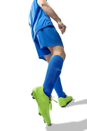 Rear view of football player man in the pose of kicking the ball isolated over white background Imagens