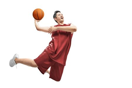 Asian man basketball player jump in the air with the ball isolated over white background Standard-Bild - 129170465