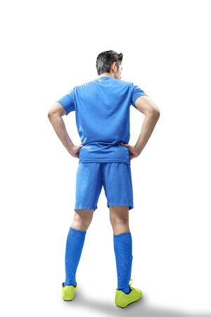 Rear view of football player man standing isolated over white background