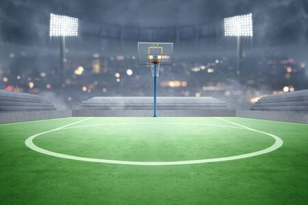 Basketball court with lights reflectors and tribune over blurred lights background Standard-Bild - 129170466