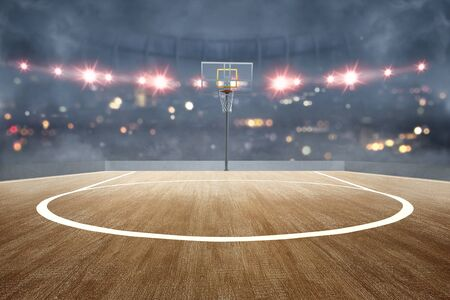 Basketball court with wooden floor and spotlights over blurred lights background Standard-Bild - 129170492