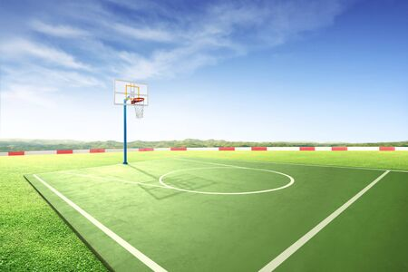 Outdoor basketball court with green grass over blue sky background