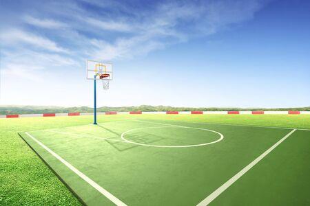 Outdoor basketball court with green grass over blue sky background Standard-Bild - 129170490