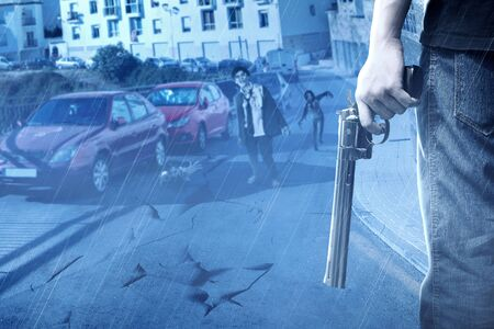 People with a gun on his hand face the zombies in the abandoned city at night. Halloween concept Фото со стока