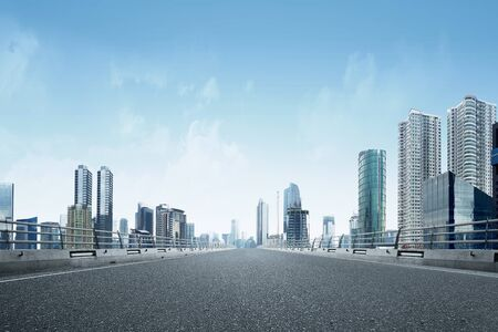 Asphalt road with modern building and skyscrapers on the midtown Banco de Imagens