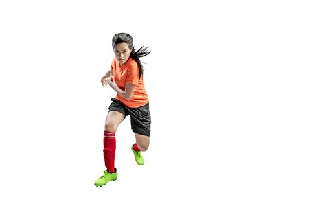 Asian football player woman in the pose of kicking the ball isolated over white background Stock Photo