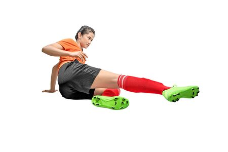 Asian football player woman on sliding tackle position isolated over white background