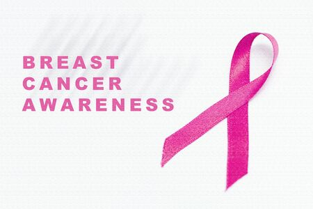 Pink ribbon with Breast Cancer Awareness message on white background. Breast cancer awareness