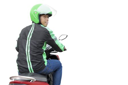 Asian motorcycle taxi man with his motorcycle isolated over white background Stock Photo