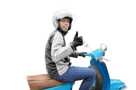 Asian motorcycle taxi man with his motorcycle showing thumbs up isolated over white background Stock Photo