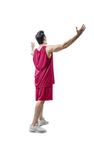 Rear view of Asian man basketball player with a happy expression isolated over white background