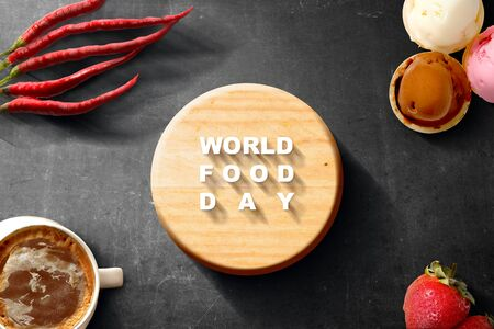 Red chilies, Strawberry fruit, A cup of coffee and Various kinds of ice cream with World Food Day text on black background. World Food Day