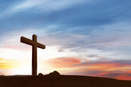 Christian Cross on the field with a blue sky background Imagens
