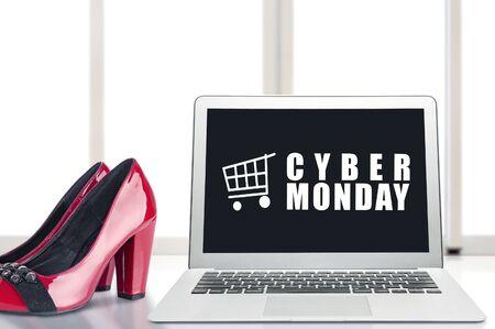 Cyber Monday advert on the laptop screen on the desk. Cyber Monday concept Reklamní fotografie