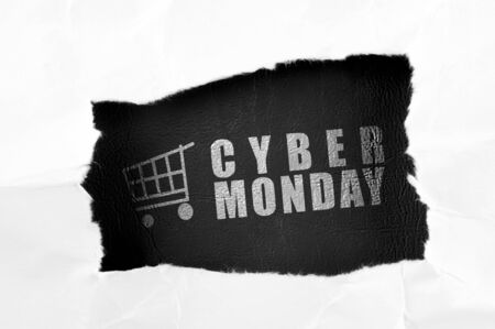 A ripped paper showing Cyber Monday text. Cyber Monday concept