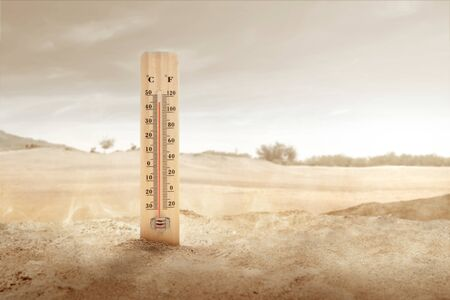 Thermometer with high temperature on the desert with sunlight background. Heatwave concept