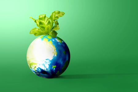 Earth with growing plants above it on the green background. Earth day concept