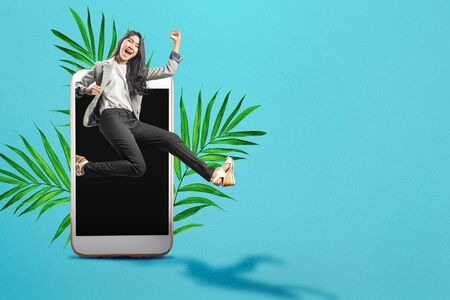 Asian businesswoman running from the phone screen. Digital Detox Concept