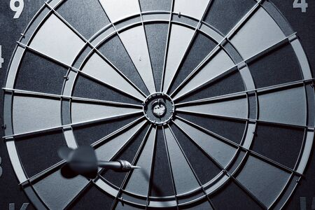 Closeup view of arrow missing the target in the darts