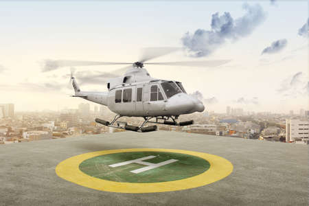 The helicopter takes off from the helipad on the city Reklamní fotografie