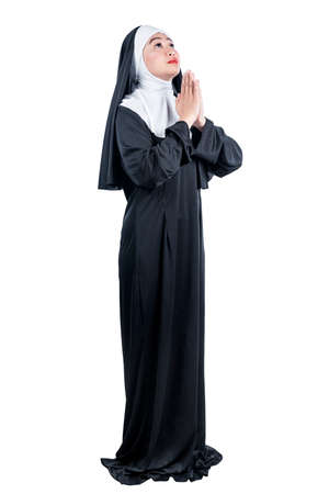 Asian nun praying isolated over white background
