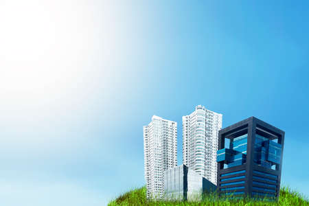 Land with buildings and apartments with a blue sky background. World Habitat Day Stock Photo