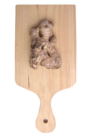 Fresh ginger on cutting board isolated over white background 写真素材