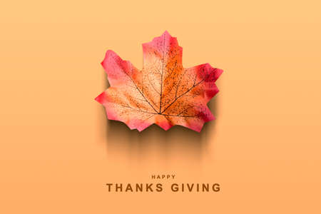 Autumn maple leaf with a colored background. Happy Thanksgiving Foto de archivo