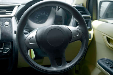 Close up view of car steering wheel inside the car