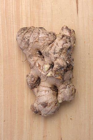 Fresh ginger on wooden background 写真素材