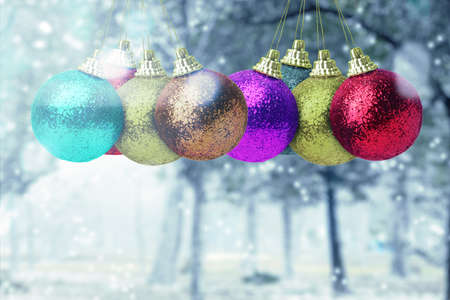 Colorful Christmas ball hanging on the tree with snowfall background. Merry Christmas Archivio Fotografico