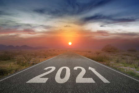 2021 on the street with a sunrise sky background. Happy New Year 2021